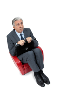 Anxious businessman sitting in a small armchair.